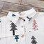 เดรสคลุมท้องสีขาวลายต้นสนคริสต์มาส กระดุมหน้าแกะได้ มีกระเป๋าด้านหน้า 1 ข้าง งานดีผ้าสวย น่ารักมากๆค่ะ thumbnail 8
