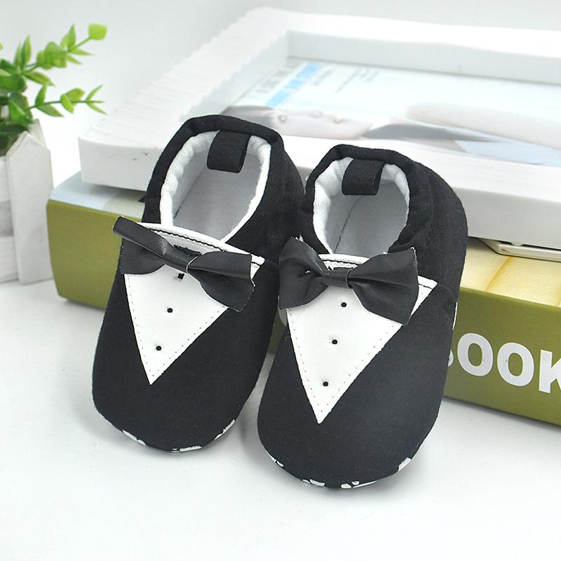 รองเท้าเด็กอ่อน 0-12เดือน รองเท้าเด็กชาย เด็กหญิง สีดำลายทักซิโด้